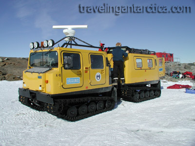 A yellow Hagglunds all terrain vehicle in Antarctica