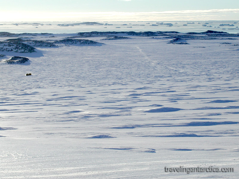 The vast emptiness of antarctica with frozen southern ocean and frozen landscape