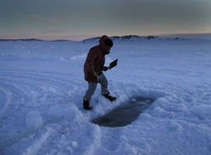 Antarctica Midwinter Digging Out Sea Ice Pool for Dip